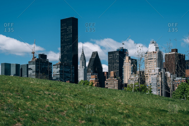 New York City - USA - May 15 2019: Midtown apartment buildings on east riverside view from Roosevelt Island