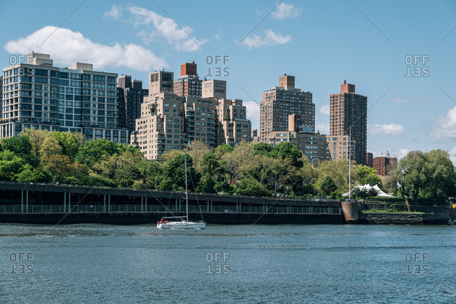 New York City - USA - May 15 2019: Upper East Side apartment building view from Lighthouse Park on Roosevelt Island