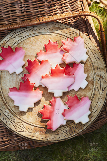 Overhead view of sugar cookies in a picnic basket decorated for Canada Day
