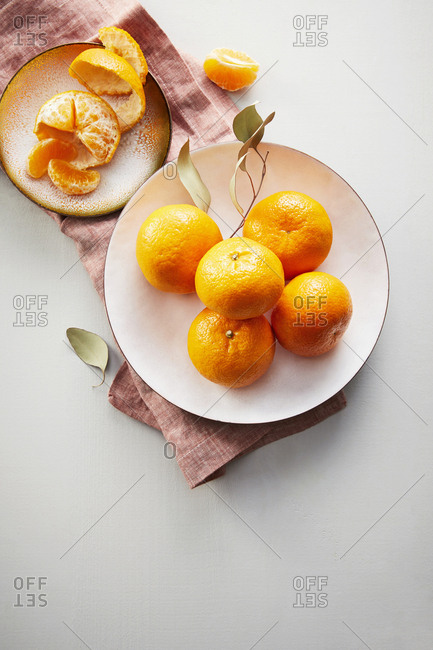 Overhead view of fresh clementines on a white counter