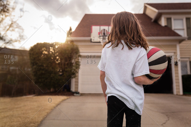 Rear view of a girl playing basketball