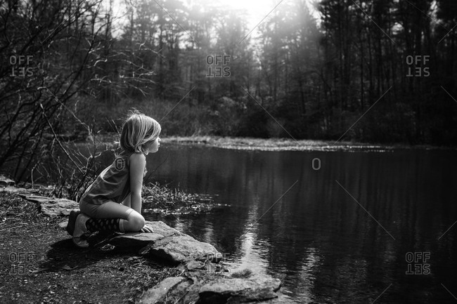 Little girl looking over a lake