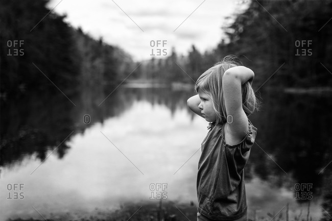 Black and white portrait of girl by a lake