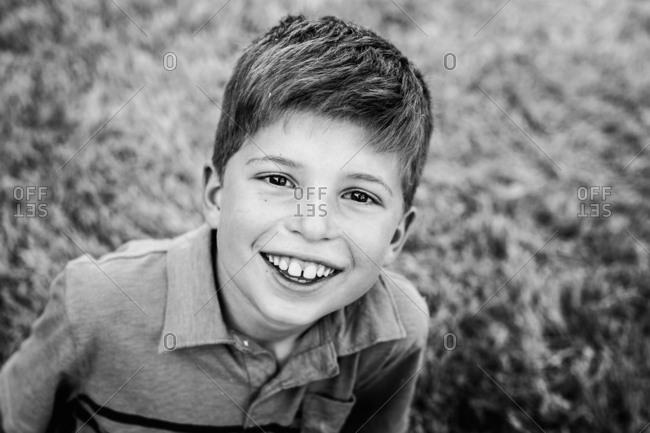 Portrait of a happy boy in black and white