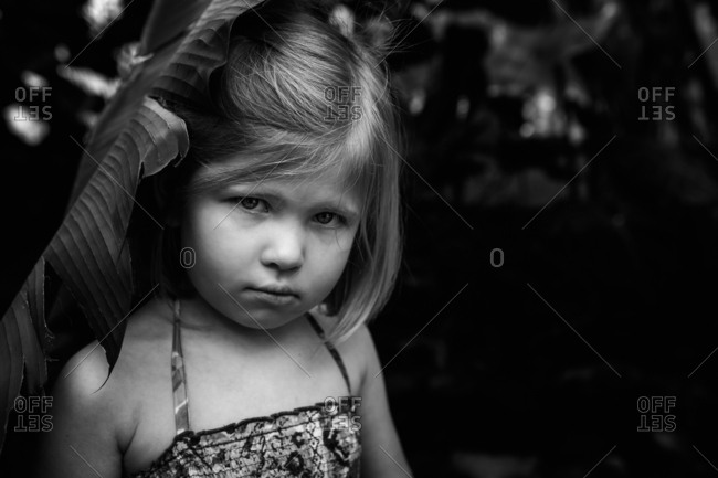 Portrait of a serious girl in black and white