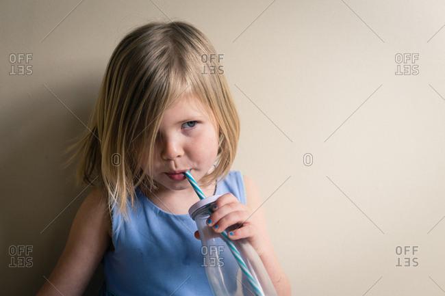 Girl drinking chocolate milk