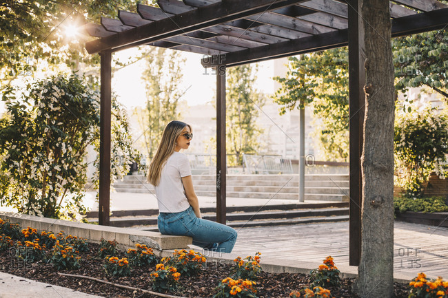 Girl sitting in a park alone