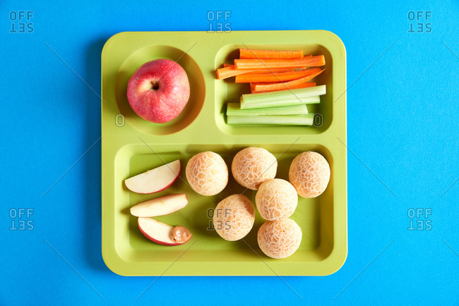 Cafeteria lunch tray with rolls, fruit and veggies