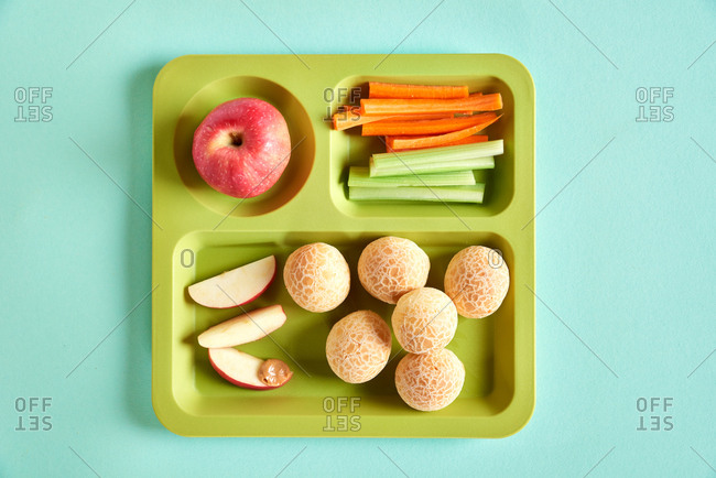 Cafeteria lunch tray with fruit and veggies