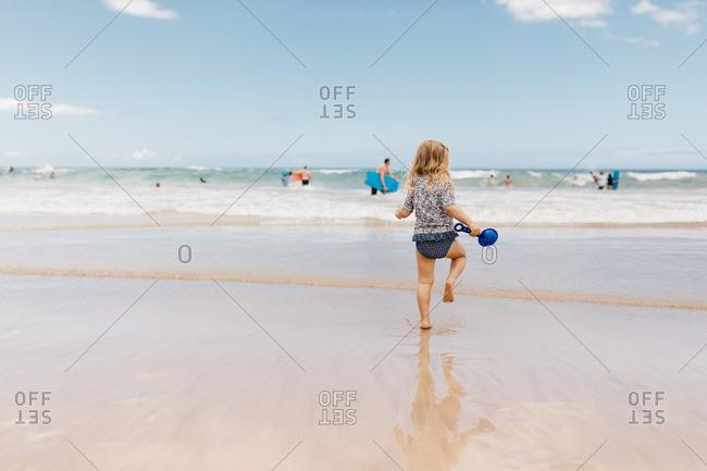 Toddler girl walking on Hawaiian beach