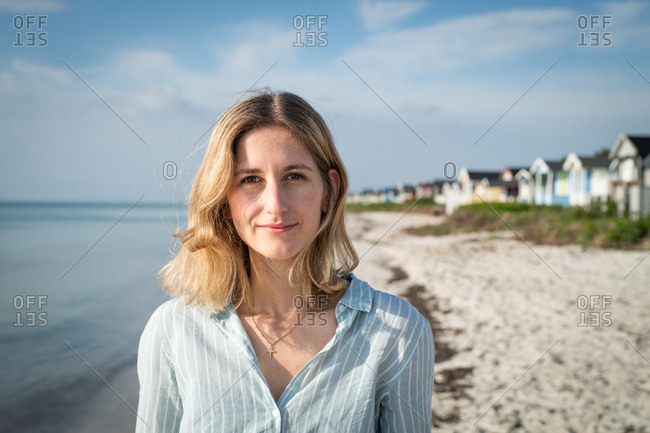 Portrait of a blonde woman standing on beach