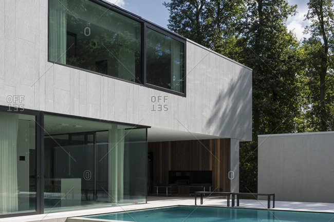 Belgium - August 13, 2013: Modern home exterior with swimming pool