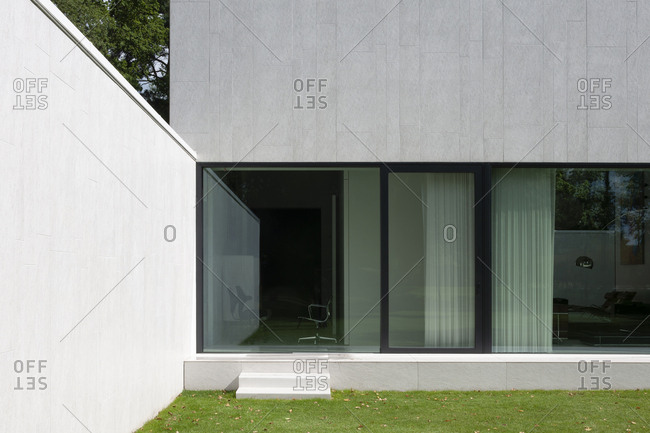 Belgium - August 13, 2013: Large glass windows on exterior of modern home