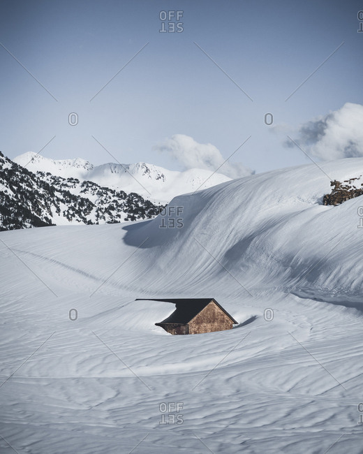 Small cabin buried in the snow