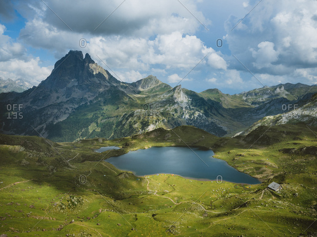 Lac d'Ayous hut with mighty Midi d'Ossau mountain in the background on summer