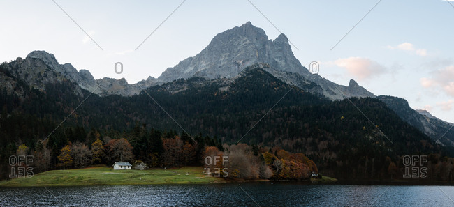 Panoramic view of Bious-Artigues lake and house on an autumn morning