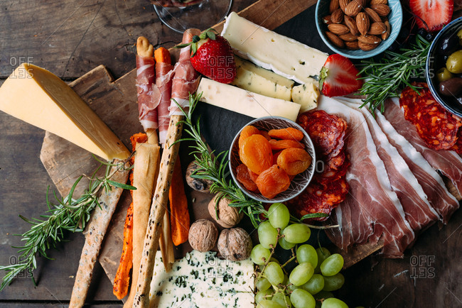 Cheese board with cured meat wine and fruit
