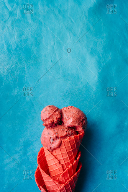 Raspberry and strawberry ice cream on turquoise leather