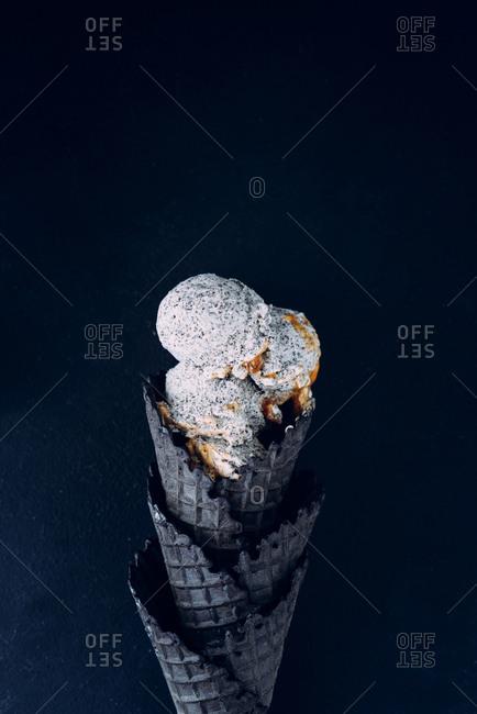 Poppy seed ice cream in black ice cream cone
