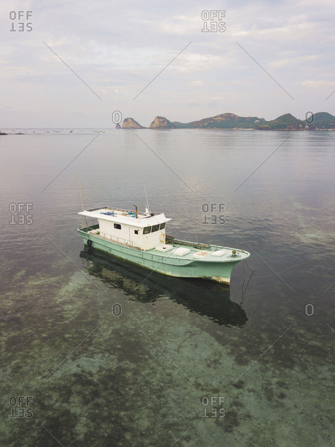 Old boat off the coast of Lombok, Indonesia
