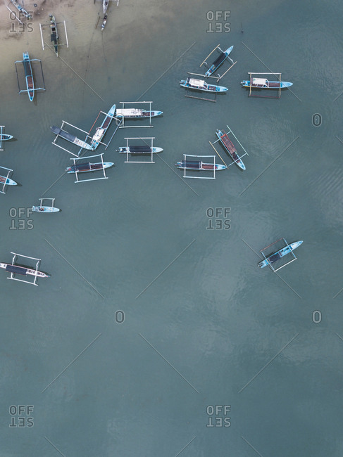 Overhead view of several banca boats in the ocean, Lombok, Indonesia