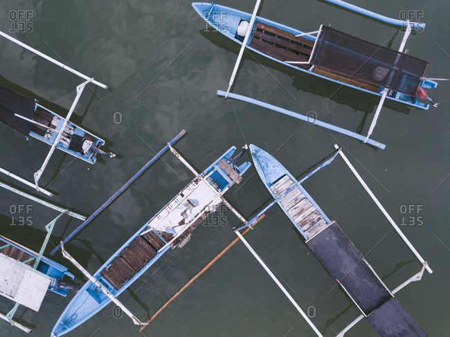Banca boats in the ocean from above