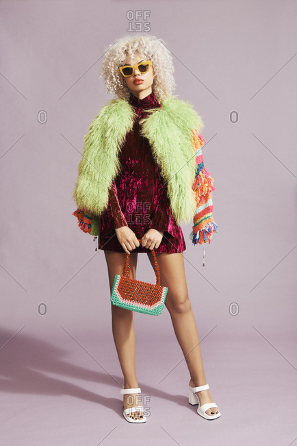 Portrait of a stylish multiracial model in a colorful oversized coat
