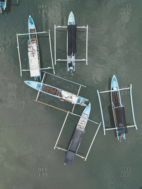 Aerial view of banca boats and surfers, Lombok, Indonesia