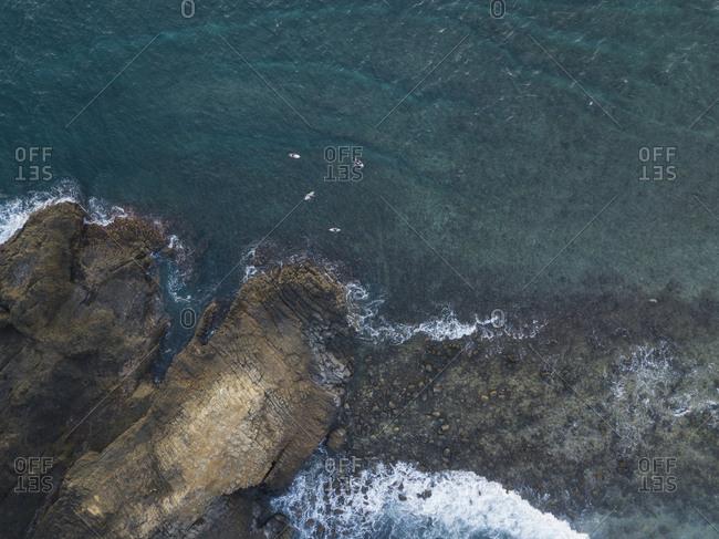 Aerila view of surfers, Lombok, Indonesia