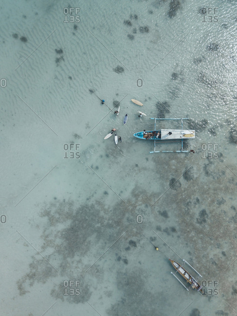 Aerial view of banca boat and surfers, Sumbawa, Indonesia