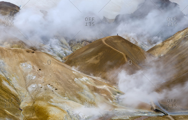 Visitors and photographers. Geothermal area Hveradalir in the mountains of Kerlingarfjoll in the highland of Iceland.
