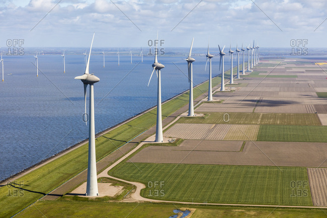 Aerial view of wind turbines at sea, North Holland, Netherlands