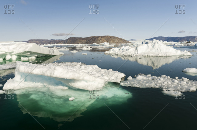 Icebergs in the Uummannaq fjord system, northwest Greenland. Glacier Store Gletscher and the ice cap in the background.