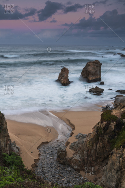 Rolling waves of the Pacific Ocean onto Garrapata Beach in Big Sur, California