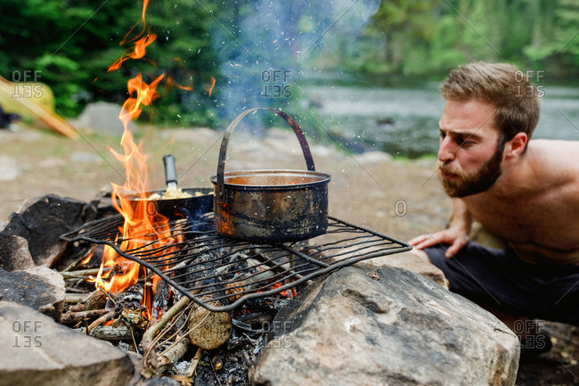 Man cooking on a campfire