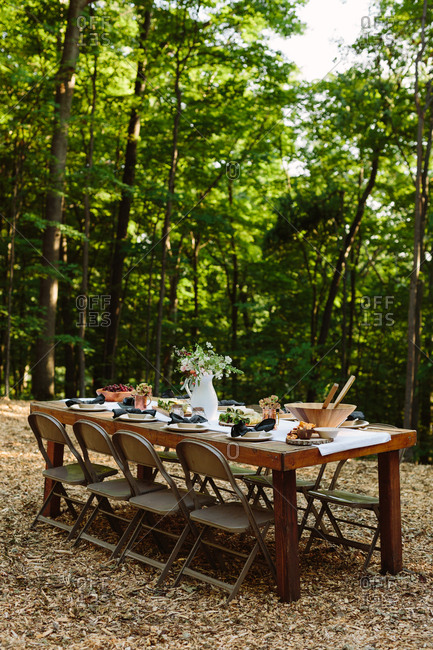 Outdoor wooden table set for a meal