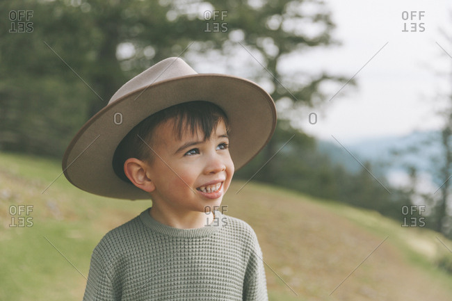Portrait of a little boy- wearing his mother's hat
