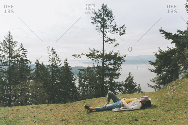 Woman relaxing in nature- lying on grass