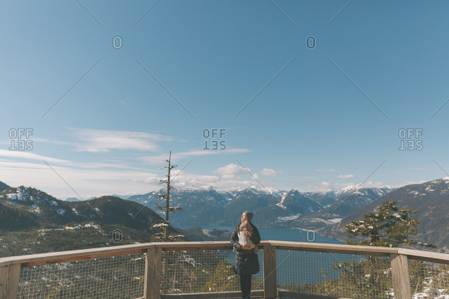 Mother holding her baby son on an observation deck- looking over Squamish- Canada