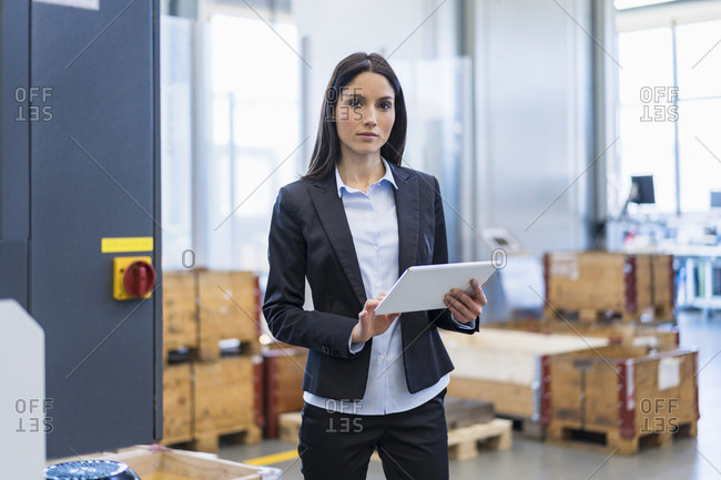 Portrait of businesswoman using tablet in a factory