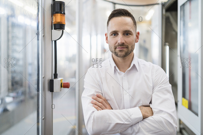 Portrait of confident businessman in a modern factory