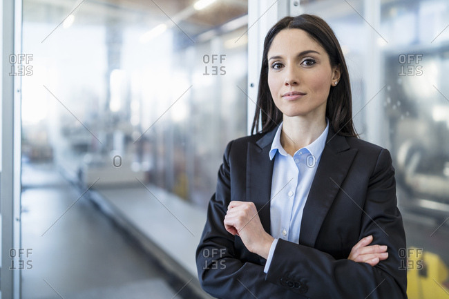 Portrait of confident businesswoman in a modern factory