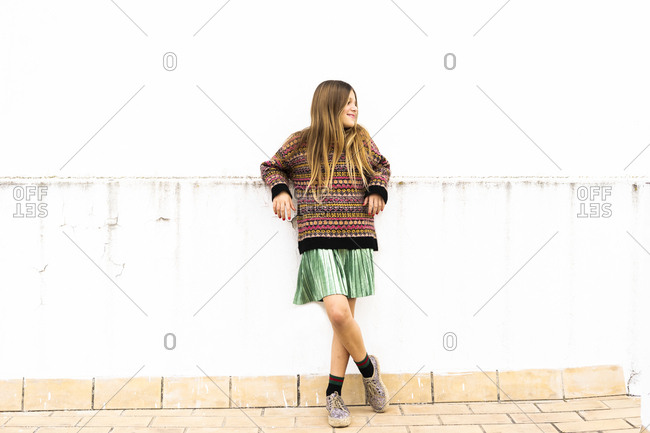 Relaxed girl standing on roof terrace