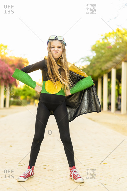 Portrait of girl posing in super heroine costume