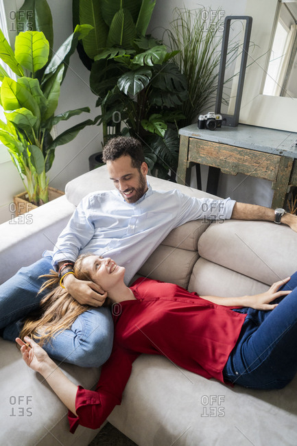 Affectionate couple relaxing on sofa