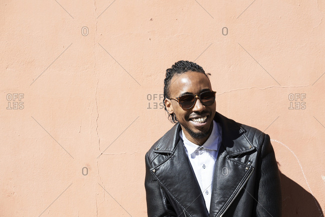Portrait of a happy young man with sunglasses outdoors