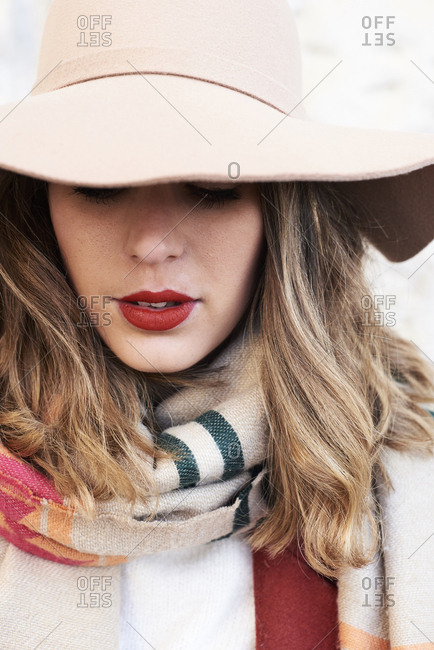 Portrait of a stylish woman wearing a floppy hat