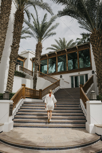 United Arab Emirates- Dubai- Lahbab Desert- woman walking on oriental stairs at a resort