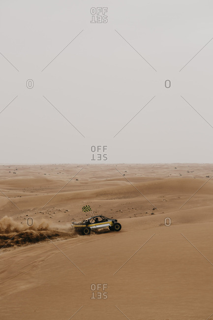 United Arab Emirates- Dubai- Lahbab Desert- 4x4 car driving through the desert