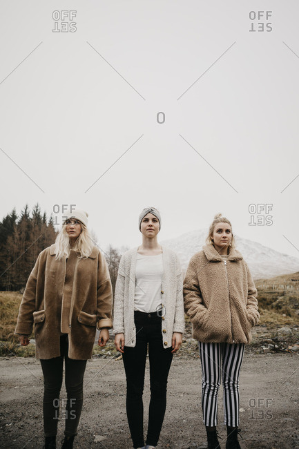 UK- Scotland- three young women standing on a path in rural landscape